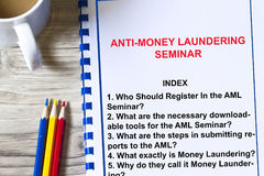 Anti money laundering concept. With topics of a lecture on a cover sheet Stock Images