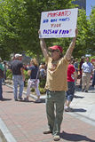Anti Monsanto and GMO Protester Holds Sign Up in Asheville, NC, Royalty Free Stock Photos