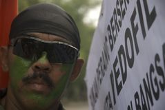 ANTI PEDOPHILIA ACTION. A man are attending anti-pedophilia protest at Solo, Java, Indonesia royalty free stock images