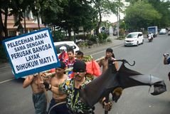 ANTI PEDOPHILIA ACTION. People attend a rally to push more harsh anti-pedophilia punishment by the government, at Solo, Java, Indonesia royalty free stock photo