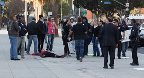 Anti police protest. Evening news under construction. A number of journalists shooting a scene about anti police protest next to Los Angeles Police Department Stock Photo