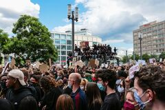 Anti-racism protest crowd at Berlin silent demo following the death of George Floyd by police violence
