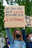 Anti-racism protester holding sign at the London Black Lives Matter protest demonstration.