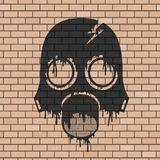 Anti raditaion mask draw in brick wall Royalty Free Stock Images