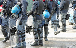 Anti-riot police cops with protective helmet during patrolling t Royalty Free Stock Images