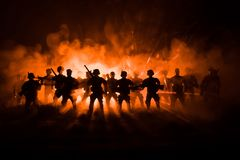 Anti-riot police give signal to be ready. Government power concept. Police in action. Smoke on a dark background with lights. Blue. Red flashing sirens Stock Photos