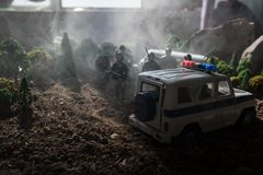 Anti-riot police give signal to be ready. Government power concept. Police in action. Blue red flashing sirens. Dictatorship power. Selective focus. Toy on royalty free stock photos