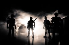 Anti-riot police give signal to be ready. Government power concept. Police in action. Smoke on a dark background with lights. Blue Stock Images