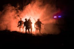 Anti-riot police give signal to be ready. Government power concept. Police in action. Smoke on a dark background with lights. Blue. Red flashing sirens Stock Photography