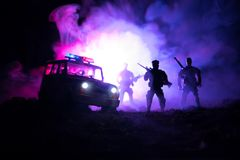 Anti-riot police give signal to be ready. Government power concept. Police in action. Smoke on a dark background with lights. Blue. Red flashing sirens Royalty Free Stock Photos