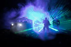 Anti-riot police give signal to be ready. Government power concept. Police in action. Smoke on a dark background with lights. Blue. Red flashing sirens Royalty Free Stock Photography
