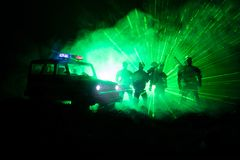 Anti-riot police give signal to be ready. Government power concept. Police in action. Smoke on a dark background with lights. Blue. Red flashing sirens Stock Image