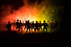 Anti-riot police give signal to be ready. Government power concept. Police in action. Smoke on a dark background with lights. Blue. Red flashing sirens Royalty Free Stock Image