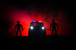Anti-riot police give signal to be ready. Government power concept. Police in action. Smoke on a dark background with lights. Blue. Red flashing sirens Stock Images