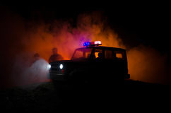 Anti-riot police give signal to be ready. Government power concept. Police in action. Smoke on a dark background with lights. Blue. Red flashing sirens Royalty Free Stock Photo