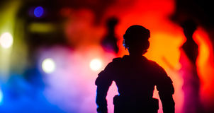 Anti-riot police give signal to be ready. Government power concept. Police in action. Smoke on a dark background with lights. Blue Royalty Free Stock Images