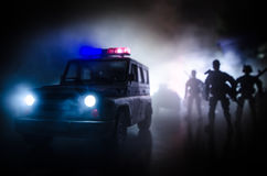 Anti-riot police give signal to be ready. Government power concept. Police in action. Smoke on a dark background with lights. Blue Royalty Free Stock Photo