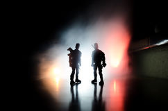 Anti-riot police give signal to be ready. Government power concept. Police in action. Smoke on a dark background with lights. Blue Royalty Free Stock Photography