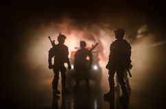 Anti-riot police give signal to be ready. Government power concept. Police in action. Smoke on a dark background with lights. Blue Stock Photo