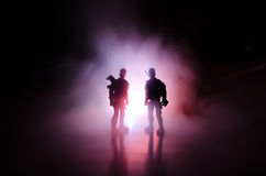 Anti-riot police give signal to be ready. Government power concept. Police in action. Smoke on a dark background with lights. Blue Royalty Free Stock Photos