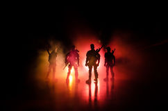 Anti-riot police give signal to be ready. Government power concept. Police in action. Smoke on a dark background with lights. Blue Stock Photography