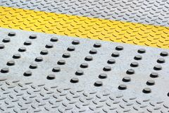 Anti-skid safety bumps on concrete floor.  Stock Images