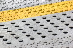Anti-skid safety bumps on concrete floor.  Stock Image