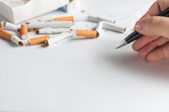 Anti-smoking background with heap of broken cigarettes Royalty Free Stock Image