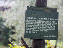 Anti song bird hunting notice. Hunting songbirds such as thrushes remains legal in Italy Stock Photo