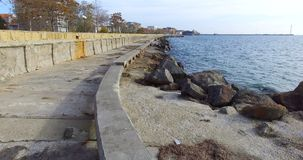 Anti-storm coastal fortifications in Pomorie, Bulgaria. Pomorie - famous resort town in Bulgaria. In summer it is a popular tourist destination, mainly from stock video footage