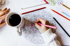 Anti-stress coloring book in the drawing process Royalty Free Stock Images