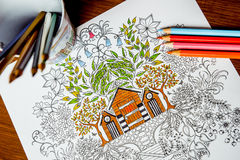 Anti-stress coloring book in the drawing process Stock Photo