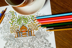 Anti-stress coloring book in the drawing process Royalty Free Stock Photography