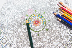 Anti-stress coloring book in the drawing process Royalty Free Stock Image