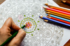 Anti-stress coloring book in the drawing process Stock Photography