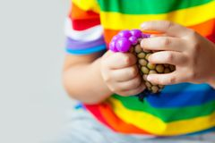 Anti Stress Face Reliever Grape Ball Autism Mood Squeeze Relief royalty free stock image