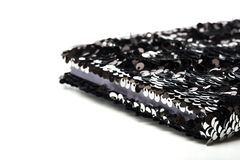 Anti-stress sequin surface notebook on white stock photo