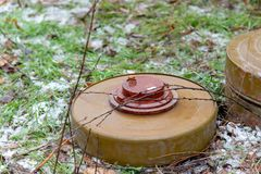 Anti-tank and anti-personnel mine for the destruction of infantry and armor stock photos