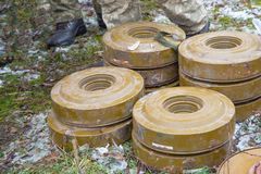 Anti-tank and anti-personnel mines without a fuse lie on the ground royalty free stock photos