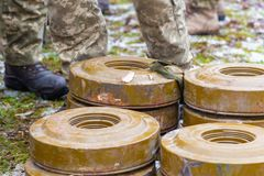 Anti-tank and anti-personnel mines without a fuse lie on the ground royalty free stock photo