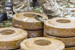 Anti-tank and anti-personnel mines without a fuse lie on the ground stock photography