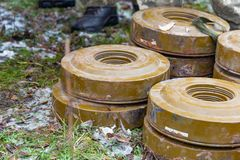 Anti-tank and anti-personnel mines without a fuse lie on the ground stock photos