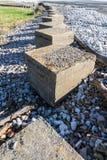 Anti Tank Cubes, Stone World War Two invasion defences. Anti-tank cubes from World War II to prevent invasion. Aberthaw beach, South Wales, United Kingdom Stock Photo