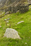 Anti Tank Cubes, World War 2 invasion defences. Four anti-tank cubes made from local stone Nant Francon Pass, Ogwen Cottage, Gwynedd, Wales, United Kingdom Stock Image