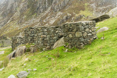 Anti Tank Cubes, World War 2 invasion defences. Four anti-tank cubes made from local stone Nant Francon Pass, Ogwen Cottage, Gwynedd, Wales, United Kingdom Royalty Free Stock Photo