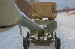 Anti-tank gun, hitched in tow, the trunk looking at the sky. The trailer to the truck guns in the sky looks the barrel Royalty Free Stock Photo