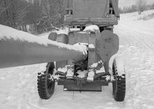 Anti-tank gun, hitched in tow, the trunk looking at the sky, white and black. White and black, the trailer to the truck guns in the sky looks the barrel Royalty Free Stock Photo
