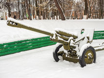 Anti-tank guns covered with snow at the park Stock Photo