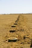 Anti tank mines. Mine field in the desert at the Israel-Jordan boundaries stock image