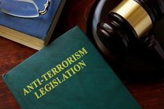 Anti-terrorism legislation title on a book. Anti-terrorism legislation title on a book and gavel in a court Stock Images